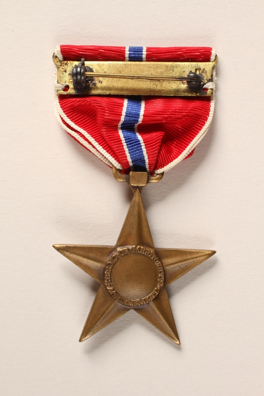 2015.255.2 a back Bronze Star medal with box and certificate awarded to a Jewish American soldier