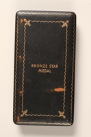 2015.255.2 b front Bronze Star medal with box and certificate awarded to a Jewish American soldier  Click to enlarge