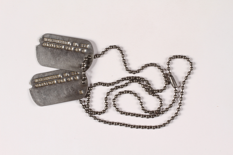 2015.255.3 front Two dog tags and a chain worn by a Jewish American soldier