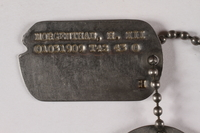 2015.255.3 detail Two dog tags and a chain worn by a Jewish American soldier  Click to enlarge