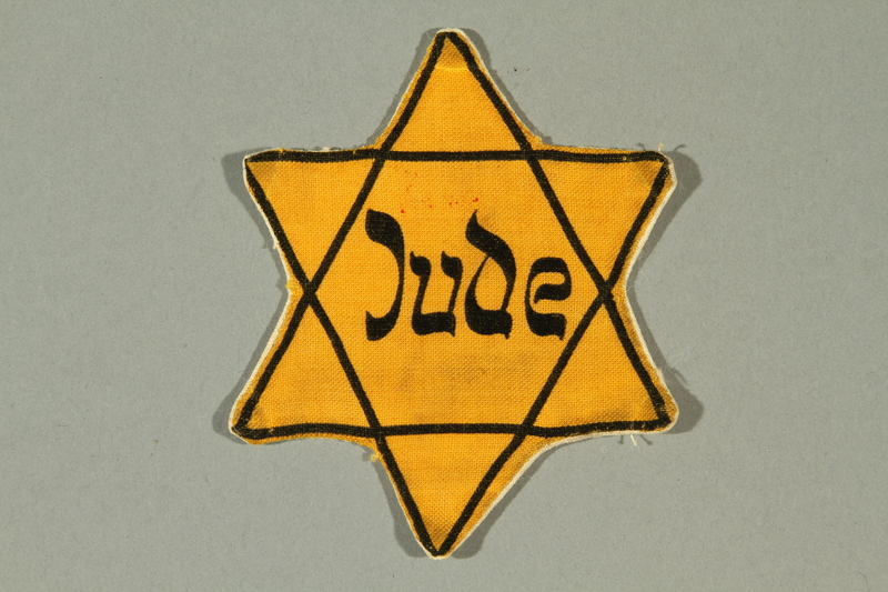 2016.249.1 front Star of David badge printed with Jude, German for Jew