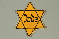 2016.249.1 front Star of David badge printed with Jude, German for Jew  Click to enlarge
