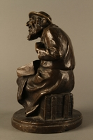 2016.184.2 left side Bronze figurine of a seated Jewish peddler  Click to enlarge