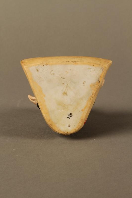 2016.184.4 bottom Ceramic change holder in the shape of an Orthodox Jewish man