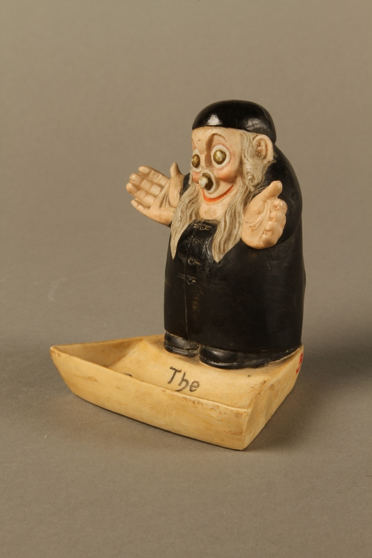 2016.184.4 left side Ceramic change holder in the shape of an Orthodox Jewish man