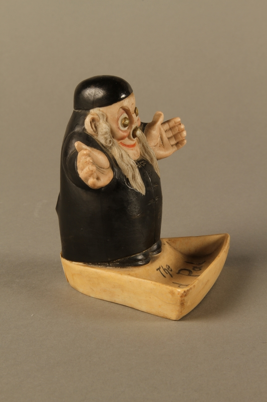2016.184.4 right side Ceramic change holder in the shape of an Orthodox Jewish man