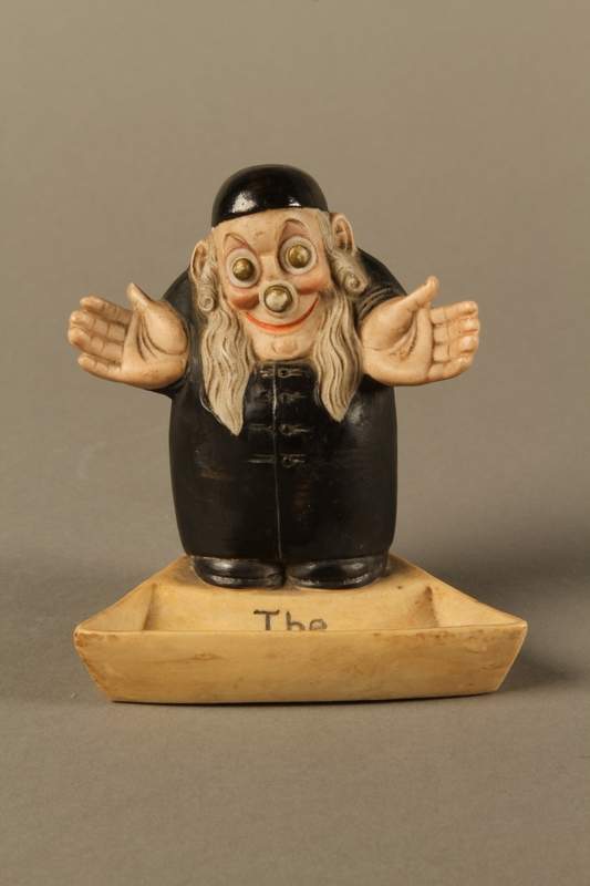 2016.184.4 front Ceramic change holder in the shape of an Orthodox Jewish man
