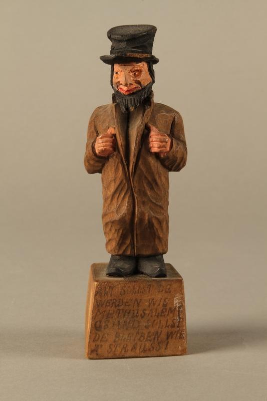 2016.184.5  front Wooden folk art figurine of a Jewish freeloader