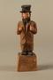 Wooden folk art figurine of a Jewish freeloader