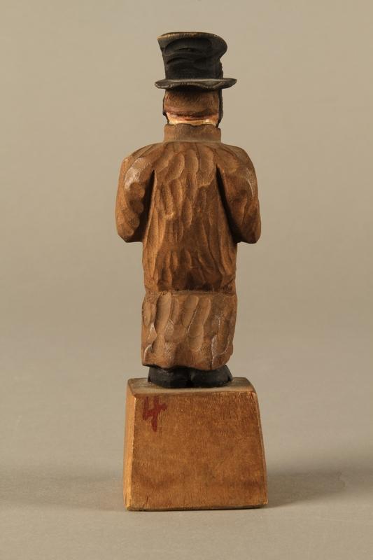 2016.184.5 back Wooden folk art figurine of a Jewish freeloader