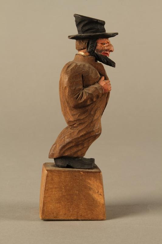 2016.184.5 right side Wooden folk art figurine of a Jewish freeloader