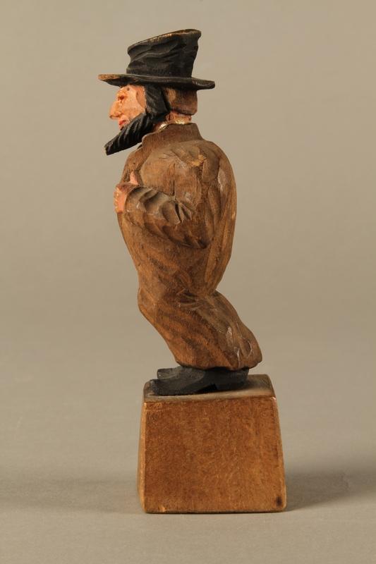 2016.184.5 left side Wooden folk art figurine of a Jewish freeloader