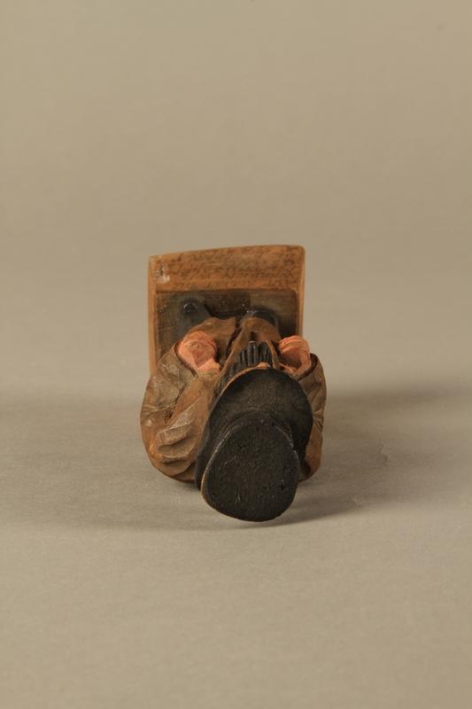 2016.184.5 top Wooden folk art figurine of a Jewish freeloader