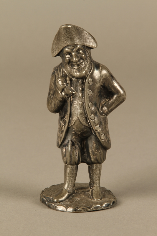2016.184.7 front Pewter pepper shaker as a bearded Jewish peddler in tricorn hat