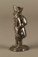 2016.184.7 left side Pewter pepper shaker as a bearded Jewish peddler in tricorn hat  Click to enlarge