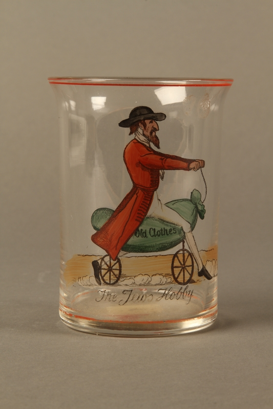 2016.184.8 front Drinking glass with caricature a Jew on his hobby horse, Old Clothes