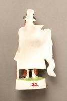 2016.184.20 back Porcelain figurine of a ribbon peddler in a red coat  Click to enlarge