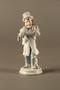 White porcelain match holder depicting a stereotypical Jewish peddler