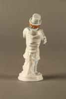 2016.184.10 back White porcelain match holder depicting a stereotypical Jewish peddler  Click to enlarge