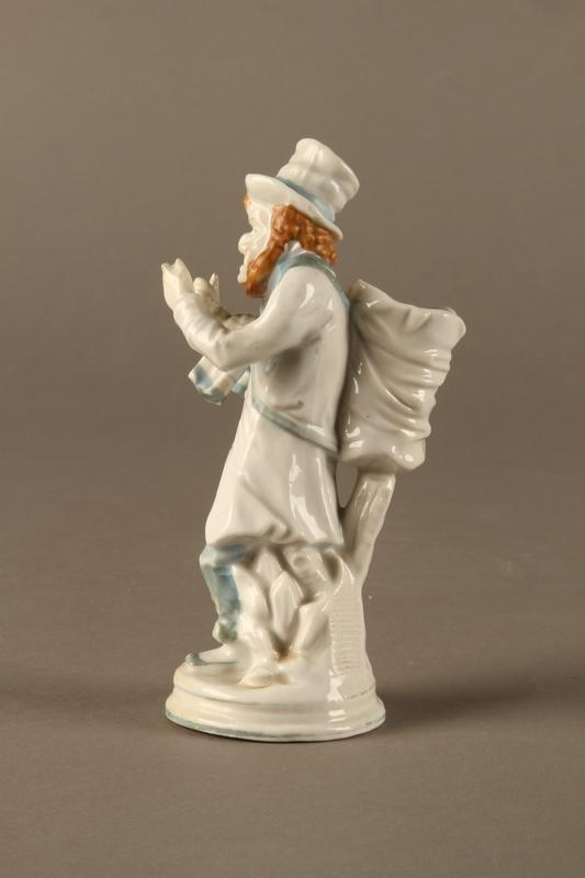 2016.184.10 left side White porcelain match holder depicting a stereotypical Jewish peddler