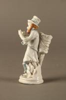 2016.184.10 left side White porcelain match holder depicting a stereotypical Jewish peddler  Click to enlarge