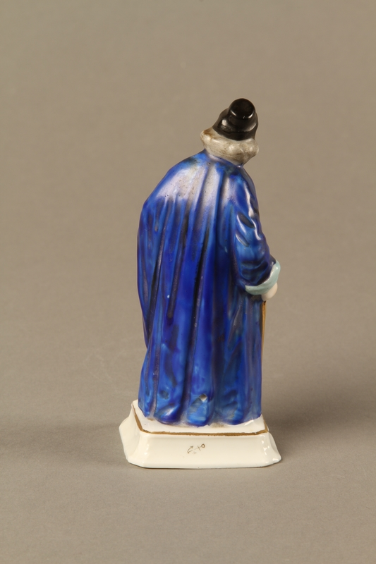 2016.184.13 back Porcelain figure of Shylock, richly dressed and carrying a dagger