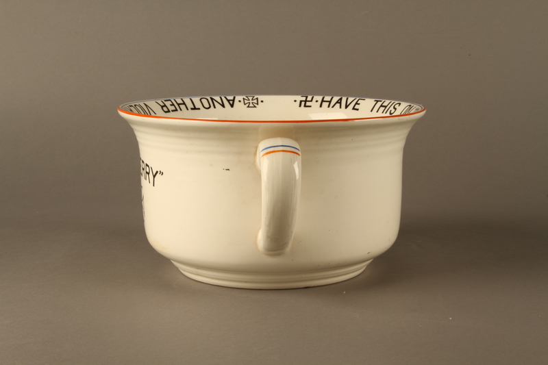 2016.184.27 left side Musical chamber pot with an image of Hitler