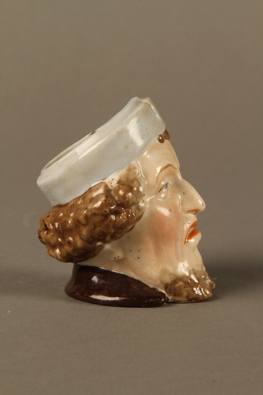 2016.184.29 right side Porcelain cup shaped as the head of a sneering Jewish man