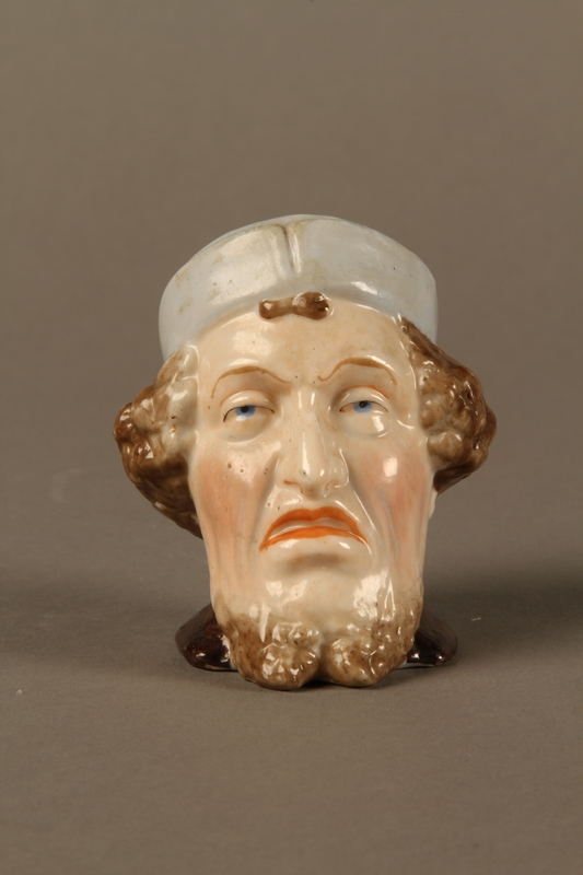 2016.184.29 front Porcelain cup shaped as the head of a sneering Jewish man