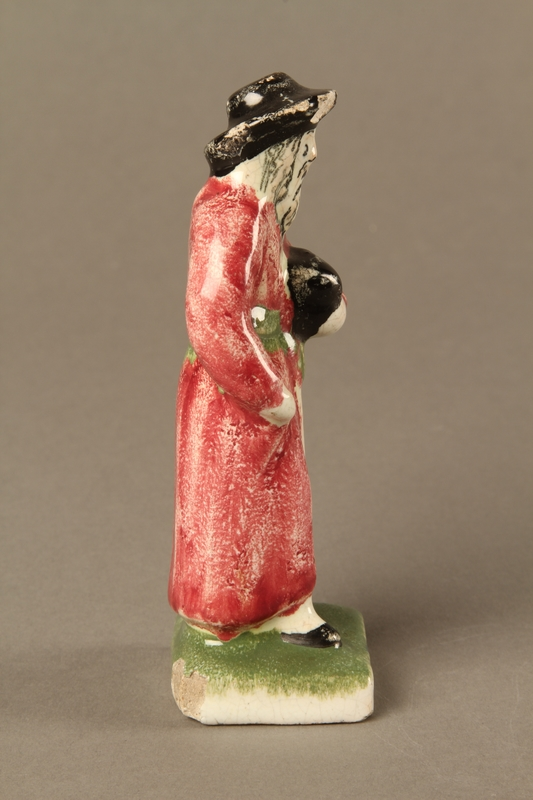 2016.184.30 right side Small ceramic figure of a Jewish man in a long red coat