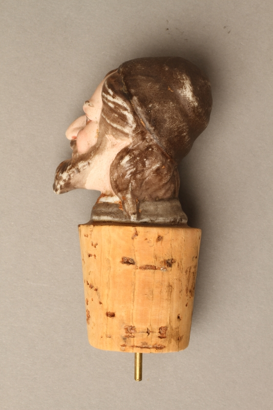 2016.184.33 left side Cork bottle stopper with a porcelain head depicting a Jewish steretoype