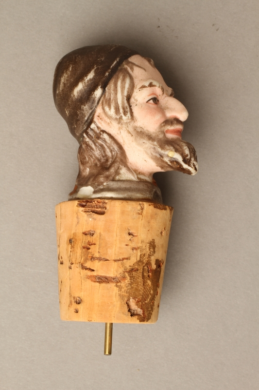 2016.184.33 right side Cork bottle stopper with a porcelain head depicting a Jewish steretoype