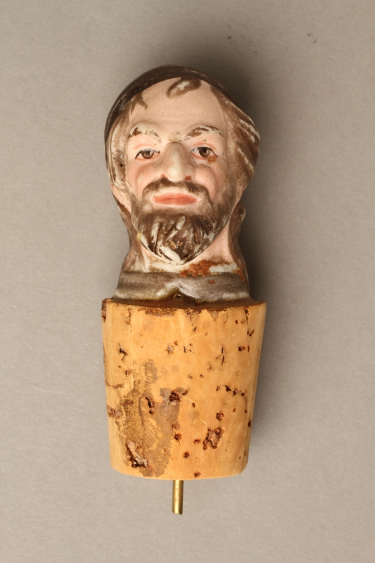 2016.184.33 front Cork bottle stopper with a porcelain head depicting a Jewish steretoype