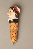 2016.184.34 left side Cork bottle stopper with a porcelain finial depicting a Jewish stereotype  Click to enlarge