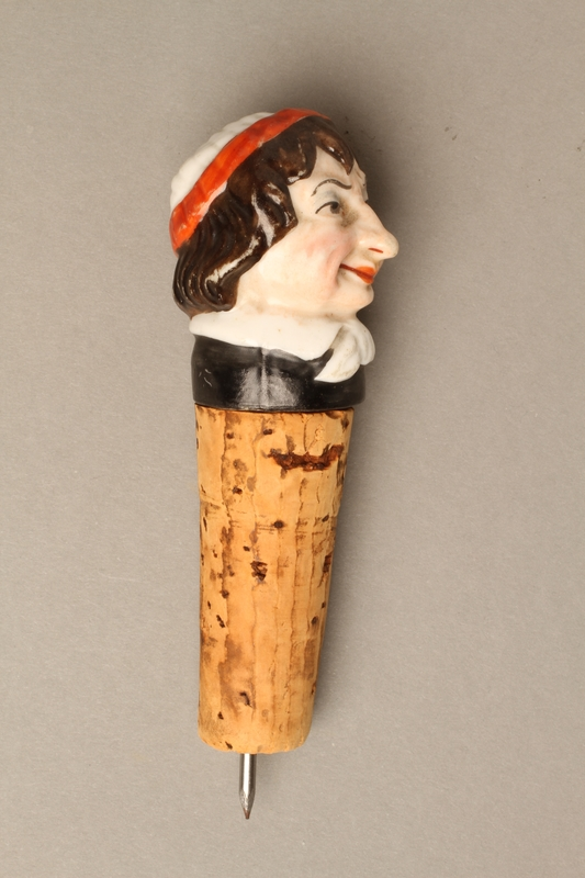 2016.184.34 right side Cork bottle stopper with a porcelain head depicting a Jewish steretoype