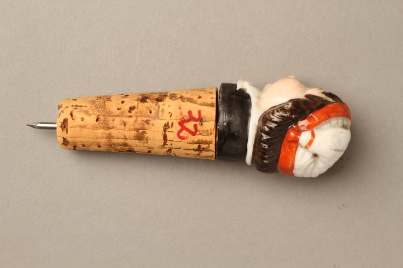 2016.184.34 back Cork bottle stopper with a porcelain finial depicting a Jewish stereotype