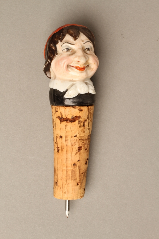 2016.184.34 front Cork bottle stopper with a porcelain head depicting a Jewish steretoype