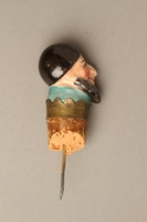 2016.184.35 right side Cork bottle stopper with a porcelain head depicting a Jewish steretoype  Click to enlarge