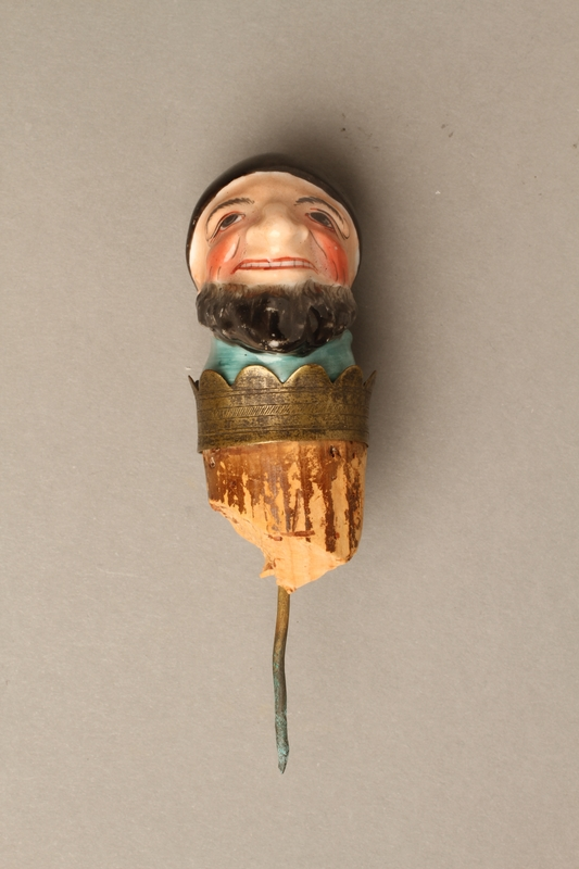 2016.184.35 front Cork bottle stopper with a porcelain head depicting a Jewish steretoype
