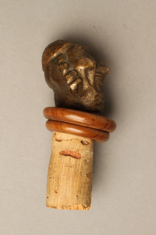 2016.184.37 right side Cork bottle stopper with a porcelain head depicting a Jewish steretoype