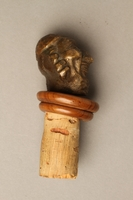 2016.184.37 right side Cork bottle stopper with a porcelain head depicting a Jewish steretoype  Click to enlarge