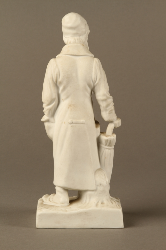 2016.184.39 back White porcelain figurine of a Jewish matchmaker with his umbrella