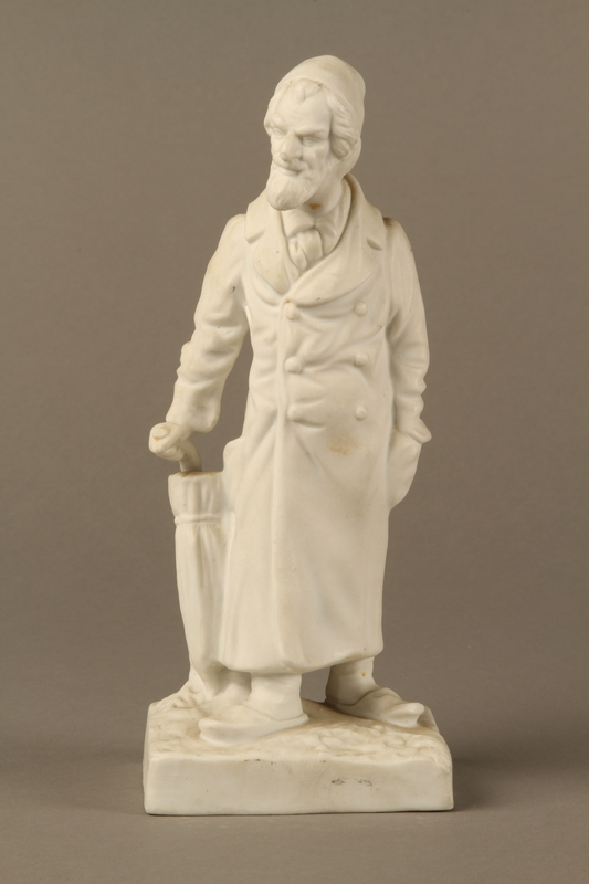 2016.184.39 front White porcelain figurine of a Jewish matchmaker with his umbrella