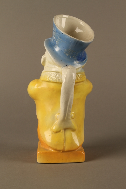 2016.184.40 back Ceramic jug shaped as a comical Jewish man with a collection box