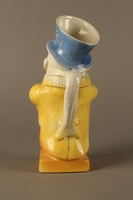 2016.184.40 back Ceramic jug shaped as a comical Jewish man with a collection box  Click to enlarge