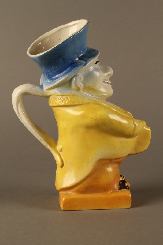 2016.184.40 right side Ceramic jug shaped as a comical Jewish man with a collection box