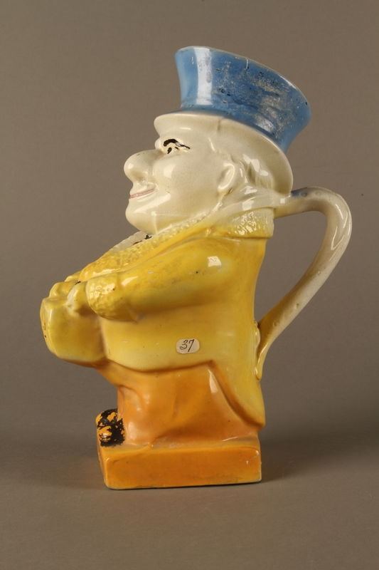 2016.184.40 left side Ceramic jug shaped as a comical Jewish man with a collection box
