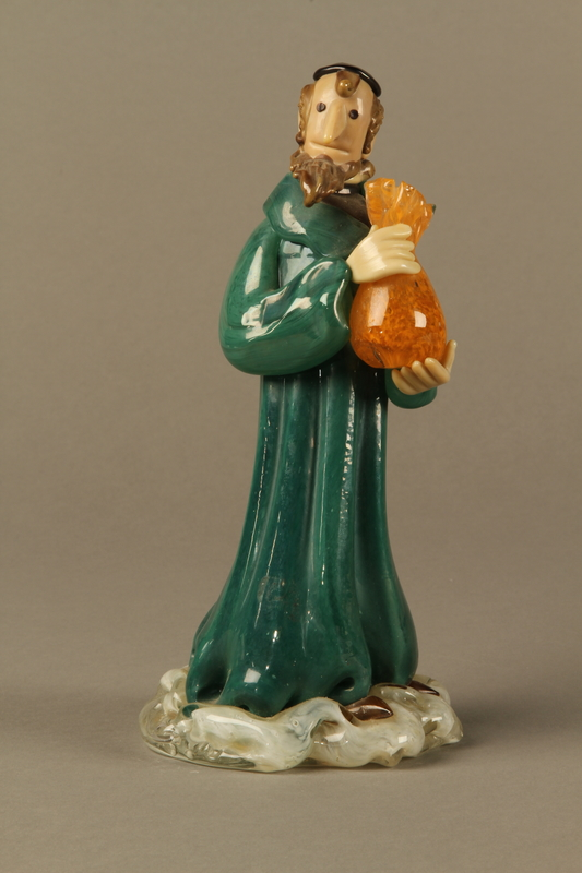 2016.184.41 front Murano glass figure of a Jew holding a full money bag