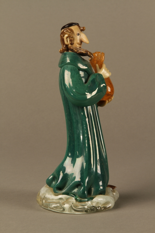 2016.184.41 right Murano glass figure of a Jew holding a full money bag
