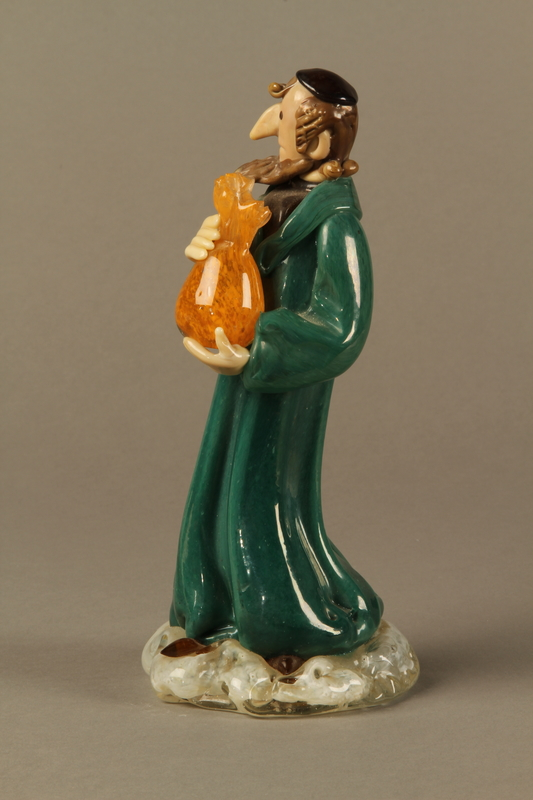 2016.184.41 left Murano glass figure of a Jew holding a full money bag